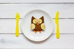 Kids menu owl shaped sandwich on white plate top view Royalty Free Stock Image
