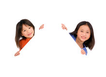 Kids Message. Two young asian girls holding a blank white sign. Put your education message here Stock Photos