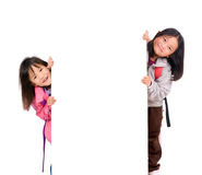 Kids Message. Two young asian girls holding a blank white sign. Put your education message here Royalty Free Stock Photo