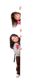 Kids Message. Two young asian girls holding a blank white sign. Put your education message here Stock Photography