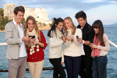 Kids with mobile or cell phones. Kids texting with mobile or cell phones stock photography