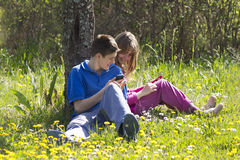 Kids with mobile phones Stock Photos