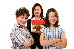 Kids and model of house isolated on white background Stock Photo