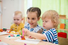 Kids doing arts and crafts in day care centre royalty free stock photography
