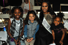 Kids models posing frontstage with miss United states during petiteParade Stock Image