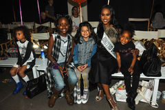 Kids models posing frontstage with miss United states during petiteParade. NEW YORK, NY - OCTOBER 17: Kids models posing frontstage with miss United states Royalty Free Stock Image