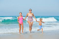 Kids and mother on the beach Royalty Free Stock Images