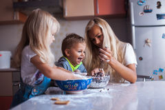 Kids with mother on kitchen Stock Image