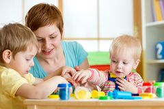 Kids and mother playing colorful clay toy Royalty Free Stock Images