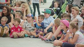 Kids and Mothers Watching Street Performance royalty free stock images