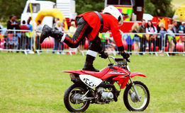 Kids on motorcycle stunt shows Royalty Free Stock Image