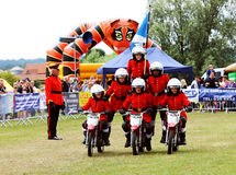 Kids on motorcycle stunt shows Stock Photo