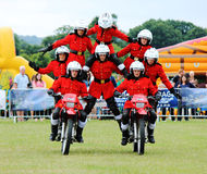 Kids on motorcycle stunt shows Royalty Free Stock Photography