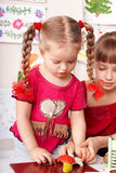 Kids mould plasticine in playroom. Royalty Free Stock Photography