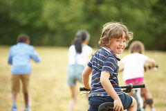 Kids with mountainbike and scooter Royalty Free Stock Images