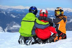Kids on mountaintop snow. Three children in snow on high mountaintop Stock Images