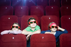 Kids in the movie theater. Kids watching 3D cartoon in the movie theater stock photo