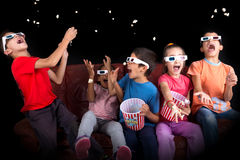 Kids in the movies Stock Images
