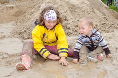 Kids in the mud Stock Photo