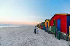 Kids at Muizenberg beach. Kids playing near famous colorful huts of Muizenberg beach near Cape Town in South Africa Royalty Free Stock Photo