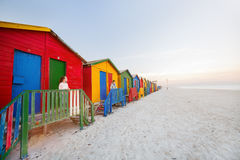 Kids at Muizenberg beach. Kids playing at famous colorful huts of Muizenberg beach near Cape Town in South Africa Royalty Free Stock Images
