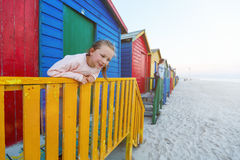 Kids at Muizenberg beach. Kids playing at famous colorful huts of Muizenberg beach near Cape Town in South Africa Royalty Free Stock Image