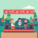 Kids music band playing at public park festival Royalty Free Stock Photos