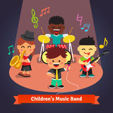 Kids music band playing and singing on stage Royalty Free Stock Images