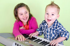 Kids in the music lessons Royalty Free Stock Photos