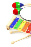 Kids musical instruments collection. Baby musical instruments collection rattle toy maracas, xylophone, tambourine isolated on white background Stock Photos
