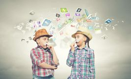 Kids with mustache. Cute girl and boy wearing shirt hat and mustache royalty free stock image