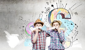 Kids with mustache. Cute girl and boy wearing shirt hat and mustache Stock Photography