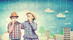 Kids with mustache. Cute girl and boy wearing shirt hat and mustache Stock Photos