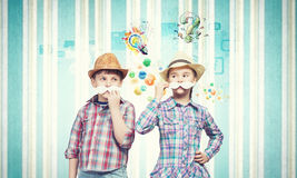 Kids with mustache. Cute girl and boy wearing shirt hat and mustache stock image