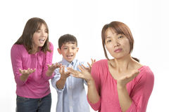 Kids nagging mom. Stock Image