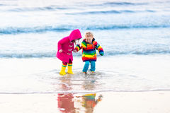 Kids on North Sea beach in winter Stock Images