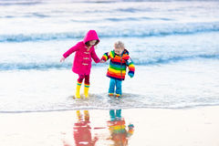 Kids on North Sea beach in winter Royalty Free Stock Photos