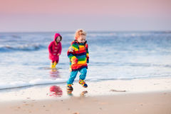 Kids on North Sea beach in winter Royalty Free Stock Images