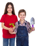 Kids with oak sapling in hands Royalty Free Stock Image