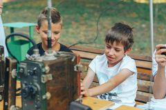 Kids with old walkie talkies royalty free stock images