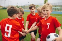 Free Kids On Football Soccer Team Putting Hands In. Boys Football School Team Huddling Stock Images - 147863774