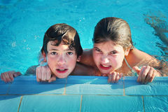 Kids in open air swimming pool. Preteen siblings boy and girl in open air  swimming pool in egypt Royalty Free Stock Photo