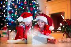 Kids Opening Christmas Presents Fire Place Stock Photos, Images ...