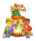 Christmas miracle - kids opening a magic gift beside a Christmas tree Royalty Free Stock Image