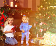 Kids opening presents in christmas home Stock Image