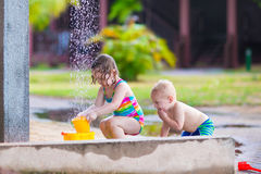 Kids in an outdoor shower Royalty Free Stock Photos
