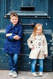 Kids outdoors in city. Brother and sister outdoors in city on beautiful spring day stock image