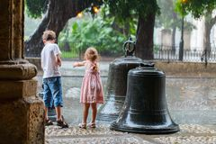 Kids outdoors in city. Kids outdoors on a street of old Havana under rain royalty free stock image