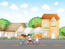 Kids outside the big houses with an empty banner Royalty Free Stock Photo
