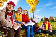 Kids outside drawing Stock Image